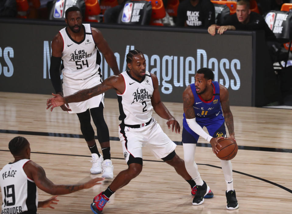 Denver Nuggets guard Monte Morris (11) is defended by Los Angeles Clippers forward Kawhi Leonard (2) in the first half of an NBA basketball game Wednesday, Aug. 12, 2020, in Lake Buena Vista, Fla. (Kim Klement/Pool Photo via AP)