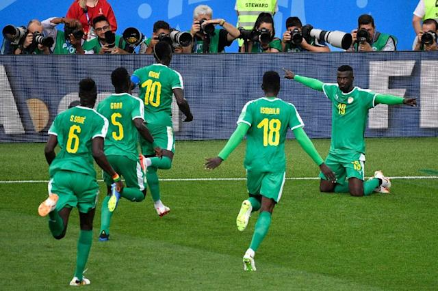 Senegal players go to celebrate with Mbaye Niang after he got what proved to be their winner against Poland (AFP Photo/Alexander NEMENOV)