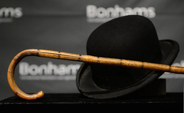Charlie Chaplain's iconic bowler hat and cane (AFP Photo/Frederic J. Brown)