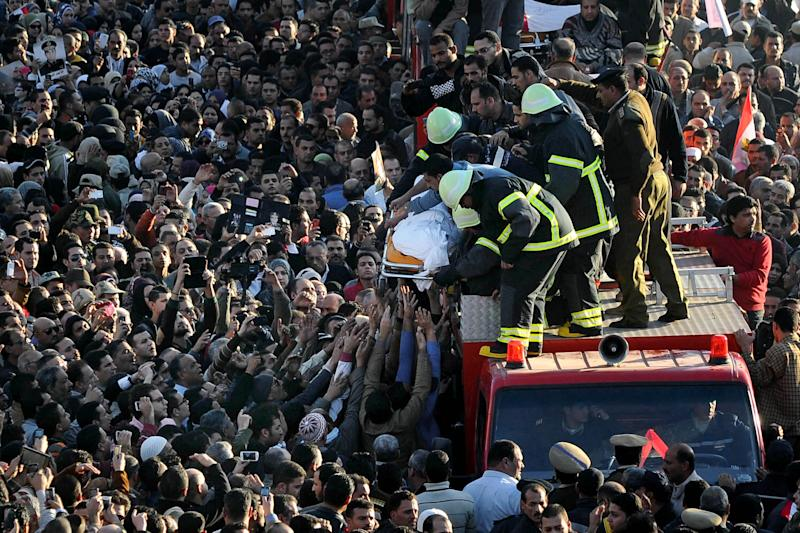 Egyptians carry the coffin of a victim killed from an explosion at a police headquarters, during the funeral procession of a dozen policeman and a civilian killed, in the Nile Delta city of Mansoura, 110 kilometers (70 miles) north of Cairo, Egypt, Tuesday, Dec. 24, 2013. A powerful blast tore through a police headquarters in an Egyptian Nile Delta city early Tuesday, killing more than a dozen, wounding more than 100 and leaving victims buried under rubble in the deadliest bombing yet in a months-long wave of violence blamed on Islamic militants. No one immediately claimed responsibility for the bombing, which came a day after an al-Qaida-inspired group called on police and army personnel to desert or face death at the hands of its fighters. (AP Photo/Ahmed Omar)