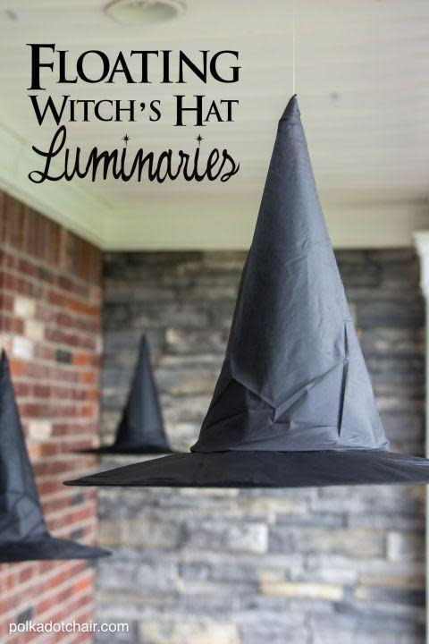 "<p>Nope, it's not witchcraft. An invisible fishing line holds up these paper caps, and they look even more magical lit up with LED lights.</p><p>Get the tutorial at <a href=""http://www.polkadotchair.com/2015/09/floating-witch-hat-luminaries.html/#_a5y_p=4332188"" rel=""nofollow noopener"" target=""_blank"" data-ylk=""slk:Polkadot Chair"" class=""link rapid-noclick-resp"">Polkadot Chair</a>.</p>"