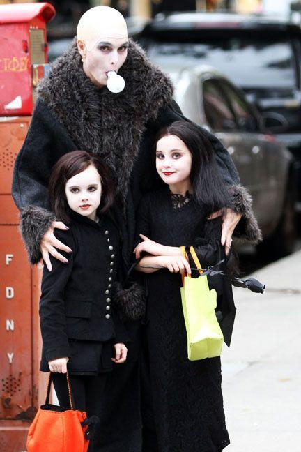 <p>As <em>The Addams Family</em>'s Uncle Fester with her daughters Rowan Francis and Grier Hammond.</p>