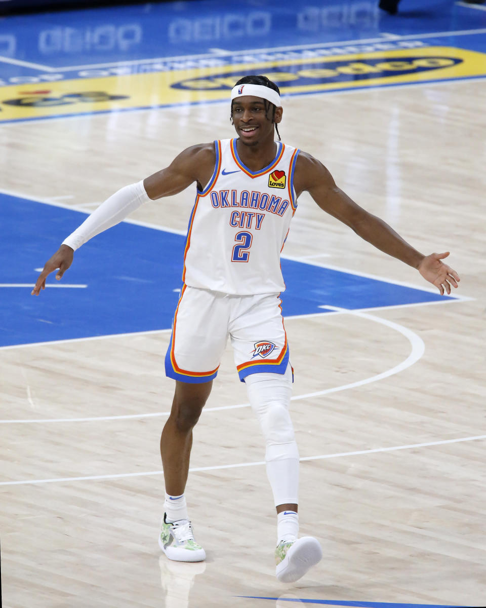 FILE - Oklahoma City Thunder guard Shai Gilgeous-Alexander (2) reacts during the second half of an NBA basketball game against the Memphis Grizzlies in Oklahoma City, in this Sunday, March 14, 2021, file photo. A franchise that had missed the playoffs just once in the previous 11 seasons finds itself in the draft lottery with a 22-50 record. Oklahoma City saw significant improvements from two of its young cornerstones in third-year guard Shai Gilgeous-Alexander and second-year guard Lu Dort. (AP Photo/Garett Fisbeck, File)