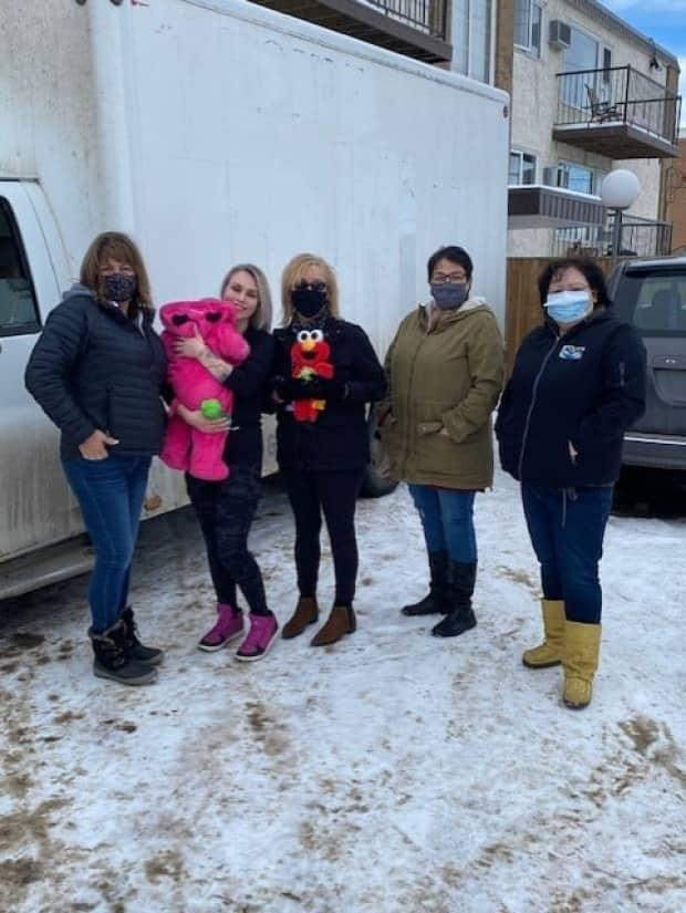 Fay Munro (second from left) was evicted from the Raising Hope program in early January but has moved into a new home with help from former Raising Hope staff. From left to right: Cheryl Deschene, Fay Munro and her daughter Onyx, Jenny Churchill, Donna Anderson Blind, and Maddie Sanderson.