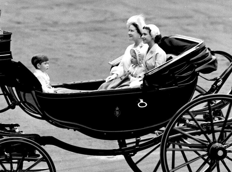 Young Prince Charles, with the Queen, Queen Mother and baby sister Princess Anne during the parade. (PA Images)