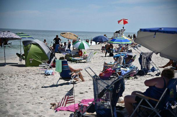 PHOTO: Beachgoers enjoy the weather at Island Beach State Park in Berkeley Township, N.J., on July 27, 2020. (Theo Wargo/Getty Images)