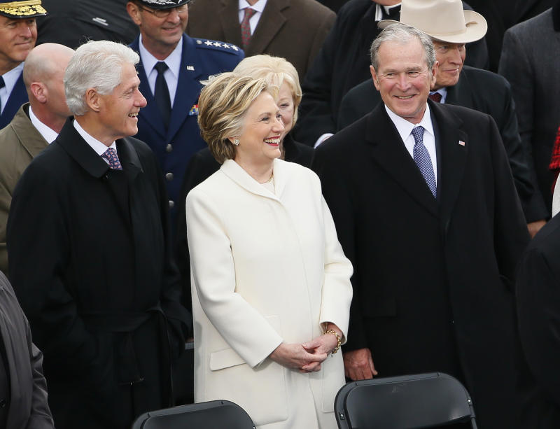 Former Secretary of State Hillary Clinton stands between former Presidents Bill Clinton and George W. Bush during inauguration ceremonies swearing in Donald Trump as the 45th president of the United States on the West front of the U.S. Capitol in Washington, U.S., January 20, 2017. REUTERS/Rick Wilking