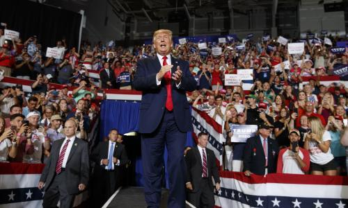 Trump rally crowd chants 'send her back' after president attacks Ilhan Omar