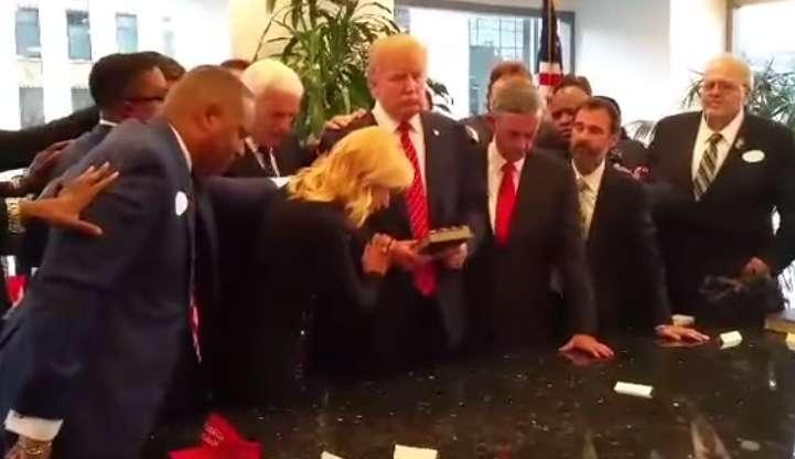 White and other prosperity preachers lay hands on Donald Trump and pray for him at Trump Tower, from a video made September 2015. (Photo: YouTube)