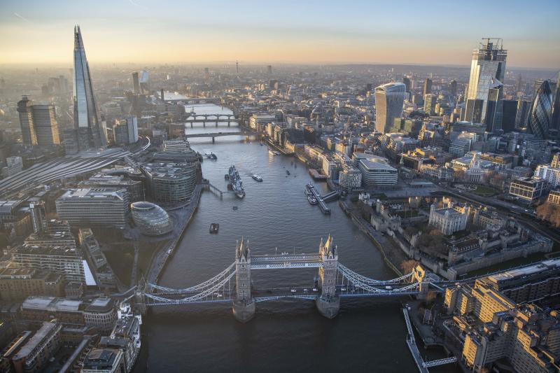 Aerial view looking along the River Thames with the Shard on one side and the skyscrapers of the City of London. (Photo: Jason Hawkes/Caters News)