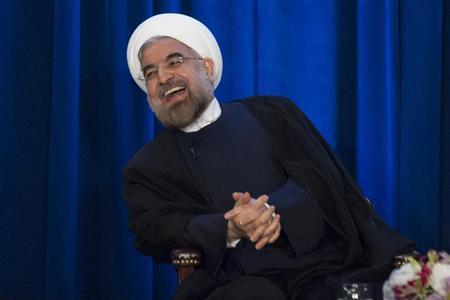 Iran's President Hassan Rohani laughs as he speaks during an event hosted by the Council on Foreign Relations and the Asia Society in New York