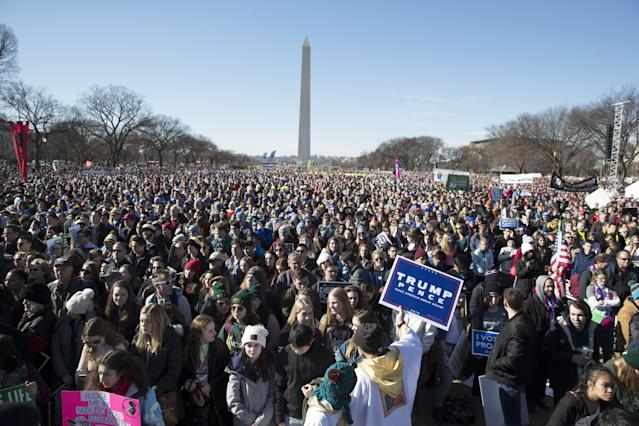 <p>Thousands of people attend the 45th March for Life, with the Washington Monument seen behind, on the National Mall in Washington, Jan. 19 2018. (Photo: Michael Reynolds/EPA-EFE/REX/Shutterstock) </p>