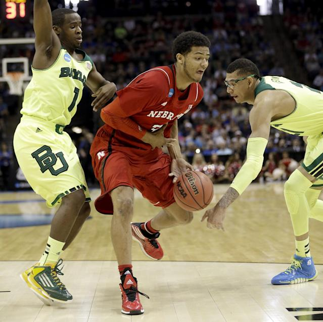 Nebraska's Shavon Shields, center, has the ball knocked away by Baylor's Isaiah Austin, right, as Kenny Chery (1) helps defend during the first half of a second-round game in the NCAA college basketball tournament Friday, March 21, 2014, in San Antonio. (AP Photo/David J. Phillip)