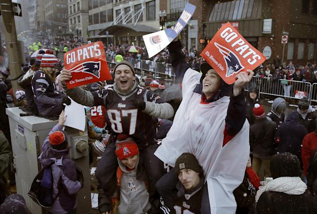 <p>New England Patriots fans wait for the start of a parade Tuesday, Feb. 7, 2017, in Boston to celebrate their team's 34-28 win over the Atlanta Falcons in Sunday's NFL Super Bowl 51 football game in Houston. (AP Photo/Charles Krupa) </p>
