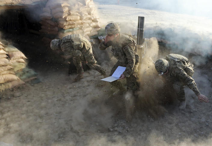 U.S. soldiers of B Troop, 1st squadron of 4th US Cavalry Regiment, fire a 120 mm mortar shell during a mortar registration exercise at COP (Combat outpost) Sar Howza in Paktika province October 29, 2012.  (Goran Tomasevic/Reuters)