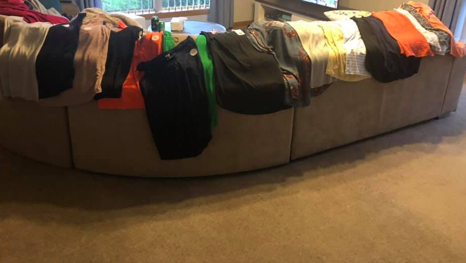 A Kmart shopper's haul of clothing including many tops after nabbing a bargain.