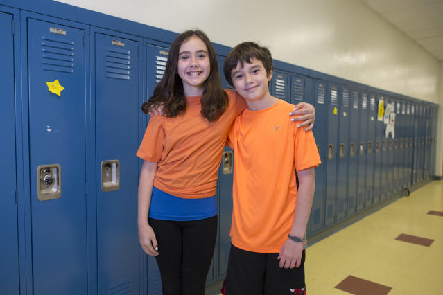 In this Thursday, June 6, 2013 photo, Chloe Karabas, left, and her twin brother, Luke, one of the 24 sets of twins from Highcrest Middle School in Wilmette, Ill., pose for a portrait in Wilmette, Ill. The group is attempting to break a Guinness Book of World Records for the amount of twins in one grade which is currently 16 sets. (AP Photo/Scott Eisen)