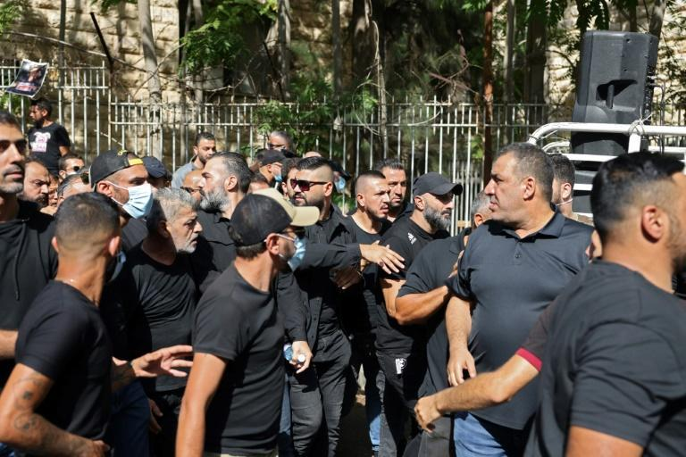 Black-clad supporters of Shiite groups Hezbollah and Amal demonstrate outside Lebanon's Palace of Justice demanding the replacement of the lead investigator into last year's monster Beirut port explosion (AFP/JOSEPH EID)