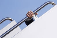 President Joe Biden holds onto the hand rail as he stumbles while boarding Air Force One at Andrews Air Force Base, Md., Friday, March 19, 2021. Biden is en route to Georgia. (AP Photo/Patrick Semansky)