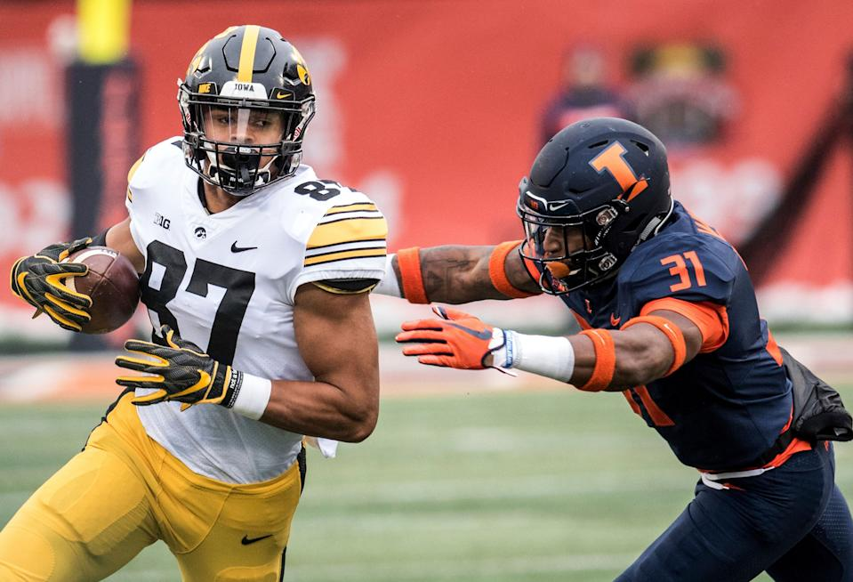 Iowa's Noah Fant (87) runs the ball after making a reception as Illinois' Cameron Watkins (31) attempts the tackle in the first half of a NCAA college football game, Saturday, Nov. 17, 2018, in Champaign, Ill. (AP Photo/Holly Hart)