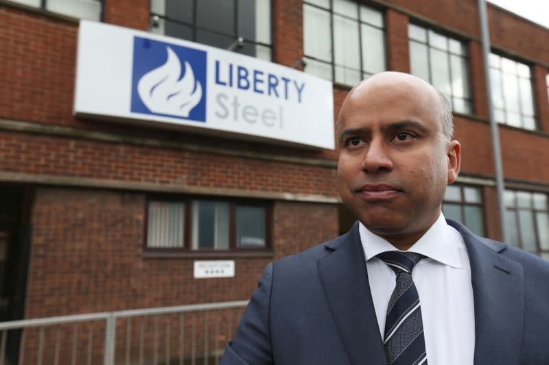 FILE PHOTO: Liberty Steel boss Sanjeev Gupta stands outside steel pressing mill in Dalzell after completing its purchase, Scotland, Britain