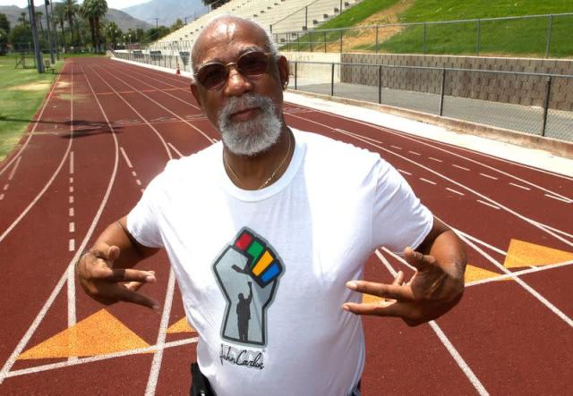 FILE PHOTO: John Carlos, participant of the 1968 Olympics, stands on the campus track at Palm Springs High School