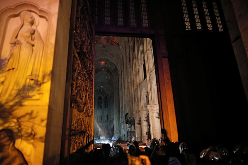 This general view from the entrance shows smoke rising in front of the altar cross at Notre-Dame Cathedral in Paris on April 15, 2019, after a fire engulfed the building. (Photo: Philippe Wojazer/AFP/Pool/Getty Images)
