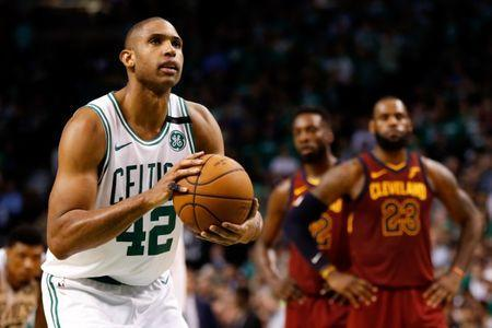 May 15, 2018; Boston, MA, USA; Boston Celtics forward Al Horford (42) attempts a free throw against the Cleveland Cavaliers after a technical on guard JR Smith (5) during the fourth quarter of game two of the Eastern conference finals of the 2018 NBA Playoffs at TD Garden. Mandatory Credit: Greg M. Cooper-USA TODAY Sports