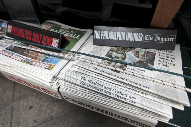 The Philadelphia Inquirer and Philadelphia Daily News newspapers sit on display on a newsstand, Monday, April 2, 2012, in Philadelphia. Philadelphia's two largest newspapers could trade hands Monday for the fifth time in six years. Several powerful local businessmen are trying to close a deal to buy The Philadelphia Inquirer and Philadelphia Daily News from New York hedge funds. (AP Photo/Matt Rourke)