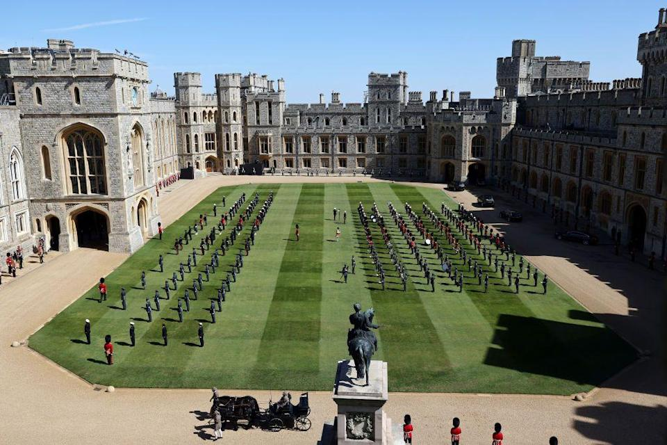 <p>Members of the military assembled on the Windsor Castle grounds, awaiting the processional. </p>