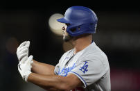 Los Angeles Dodgers pinch-hitter Albert Pujols gestures to the dugout after hitting an RBI-single off Colorado Rockies relief pitcher Jhoulys Chacin in the 10th inning of a baseball game Tuesday, Sept. 21, 2021, in Denver. The Dodgers won 5-4. (AP Photo/David Zalubowski)
