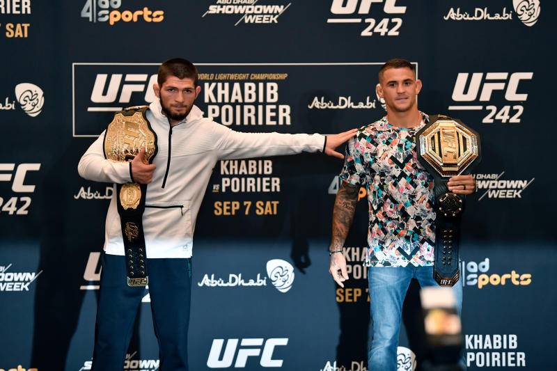 ABU DHABI, UNITED ARAB EMIRATES - SEPTEMBER 05: (L-R) Khabib Nurmagomedov of Russia and Dustin Poirier pose for media during the UFC 242 Ultimate Media Day at the Yas Hotel on September 5, 2019 in Abu Dhabi, United Arab Emirates. (Photo by Jeff Bottari/Zuffa LLC/Zuffa LLC via Getty Images)