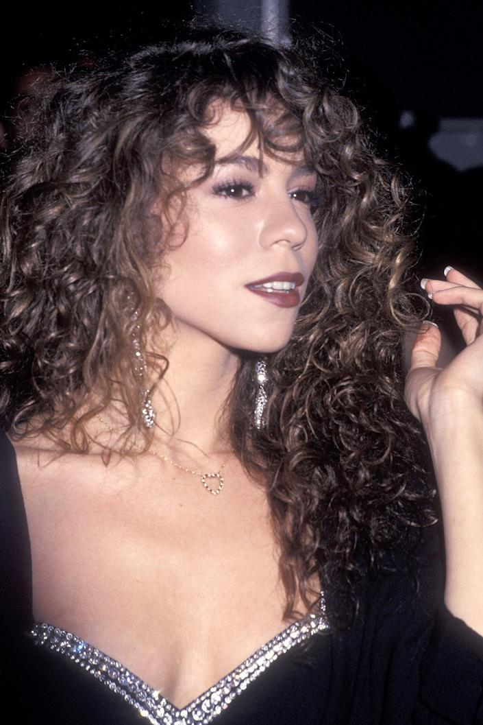 """<h3>Mariah Carey, 1991</h3><br>Mariah Carey stunned back in 1991 by wearing her natural, long ringlets loose and wonderfully imperfect.<span class=""""copyright"""">Photo: Ron Galella Ltd./Ron Galella Collection/Getty Images.</span>"""