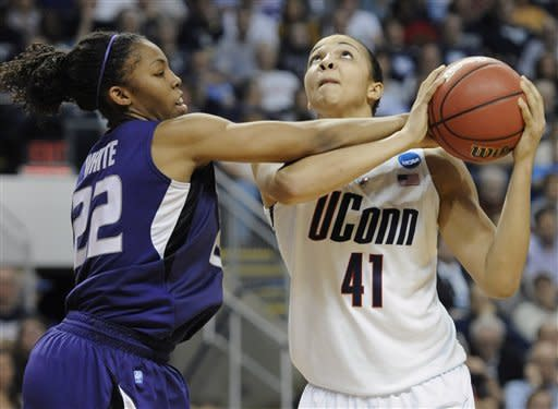 Connecticut's Kiah Stokes, right, is fouled by Kansas State's Mariah White during the second half of an NCAA tournament second-round college basketball game in Bridgeport, Conn., Monday, March 19, 2012. Connecticut 72-26. (AP Photo/Jessica Hill)