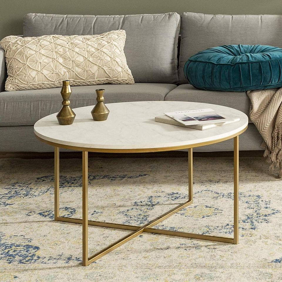 """<p>We love the gold detail on this <a href=""""https://www.popsugar.com/buy/WE-Furniture-Modern-Round-Coffee-Accent-Table-517040?p_name=WE%20Furniture%20Modern%20Round%20Coffee%20Accent%20Table&retailer=amazon.com&pid=517040&price=113&evar1=casa%3Aus&evar9=45791994&evar98=https%3A%2F%2Fwww.popsugar.com%2Fhome%2Fphoto-gallery%2F45791994%2Fimage%2F46895962%2FWE-Furniture-Modern-Round-Coffee-Accent-Table&list1=shopping%2Camazon%2Chome%20decor%2Cfurniture&prop13=mobile&pdata=1"""" rel=""""nofollow"""" data-shoppable-link=""""1"""" target=""""_blank"""" class=""""ga-track"""" data-ga-category=""""Related"""" data-ga-label=""""https://www.amazon.com/WE-Furniture-Coffee-Living-Marble/dp/B071YPHMY6/ref=sr_1_3?keywords=modern+furniture&amp;qid=1573674000&amp;sr=8-3"""" data-ga-action=""""In-Line Links"""">WE Furniture Modern Round Coffee Accent Table</a> ($113, originally $124).</p>"""