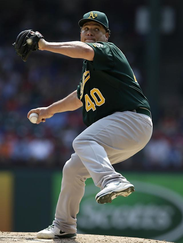 Oakland Athletics' Bartolo Colon (40) works against the Texas Rangers in the fifth inning of a baseball game, Saturday, Sept. 14, 2013, in Arlington, Texas. (AP Photo/Tony Gutierrez)