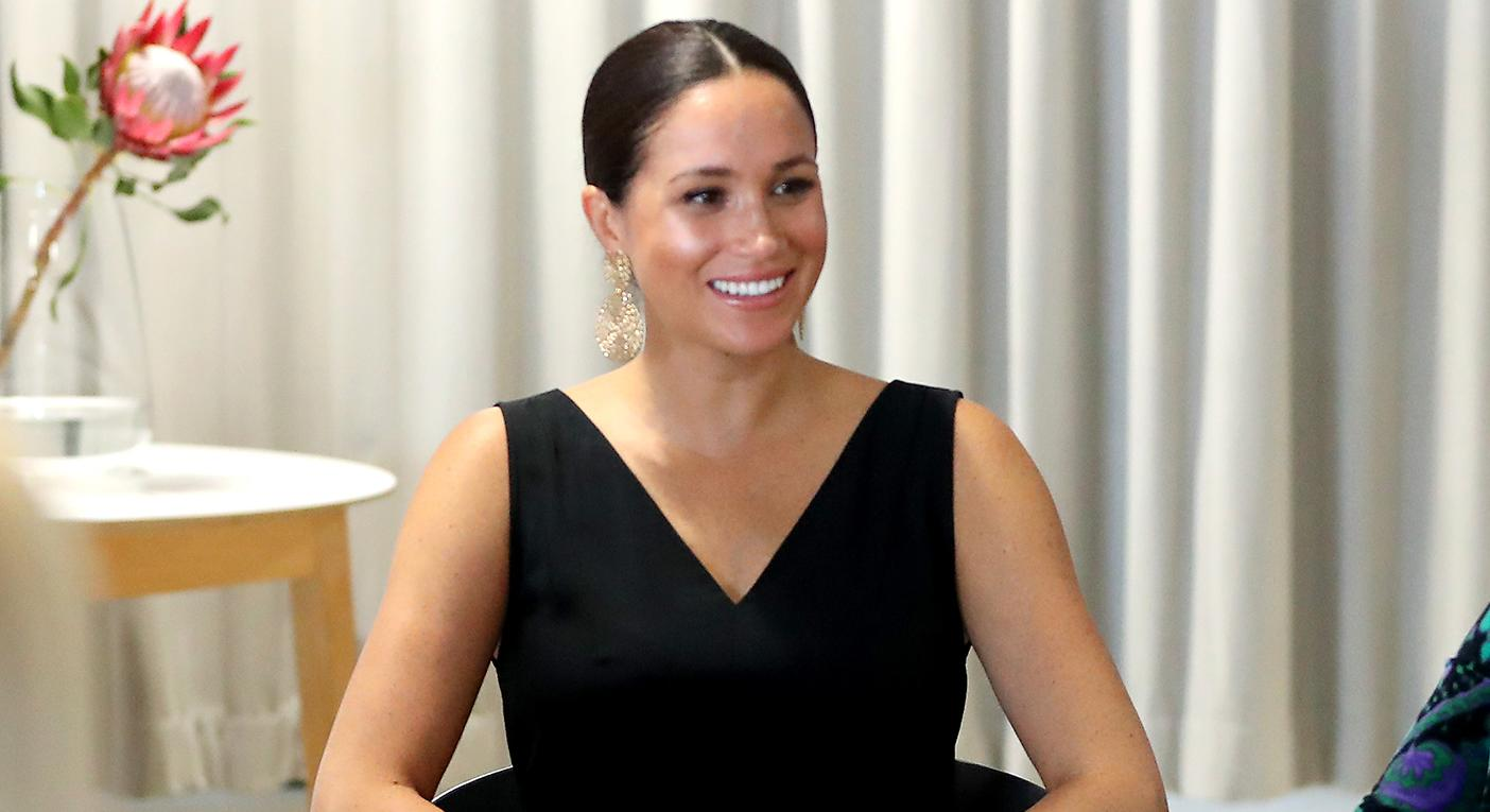 Meghan wore her Everlane jumpsuit for her first solo engagement of the royal tour [Photo: Getty]