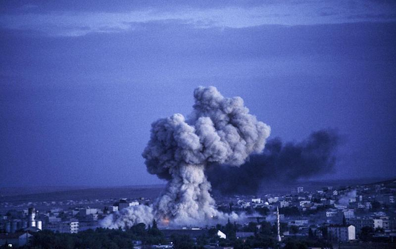 Smoke rises following an explosion in the Syrian town of Kobane, also known as Ain al-Arab, on October 20, 2014