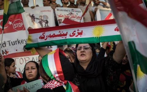 """An offer by Kurdistan's leaders to """"freeze"""" their plans for independence have been rejected outright by Iraq's prime minister, who ordered his forces to push yet further into territory held by the Kurds. Iraq's central government """"will accept only the cancelling of the referendum,"""" Haider al-Abadi said in a statement on Thursday, warning he would protect the unity of Iraq with """"high precision."""" Appearing to reject the olive branch, Iraqi troops launched an offensive against Kurdish fighters near the border with Turkey and Syria. The Fishkhabour and Habur border crossings are vital trading routes for Kurdistan as they host the pipelines through which they export hundreds of thousands of barrels of crude oil to Turkey. """"Iraq's back in civil war,"""" Aziz Ahmad, an adviser to the chancellor of the Kurdistan Region's security council,said. """"Today's attack deepens public resentment in Kurdistan (…) in the next 24 hours Abadi will have squandered the world's support."""" Iraqi Kurds wave flags and chant slogans during a protest outside the US Consulate on October 21, 2017 in Erbil, Iraq. Credit: Getty Sporadic fighting has erupted over the past week between Kurdish and Iraqi forces, former allies in the battle against the Islamic State of Iraq and the Levant (Isil), as government forces with allied mostly Shia militias retook the contested areas, including the city of Kirkuk. After days of largely low-level clashes, Kurdish leaders on Wednesday offered to suspend the September vote results to facilitate talks with Baghdad and end the violence. Should the border crossing fall back into Iraq's hand, not only would Iraqi Kurds lose a main trading route, the US-led coalition could lose access to its allies in Syria battling Isil. The spokesman for the coalition said recent fighting has impeded the movement of its military equipment in both Iraq and Syria, negatively impacting the campaign against the jihadist group. Mr Abadi's statement came as he met with Iranian officials in Tehr"""