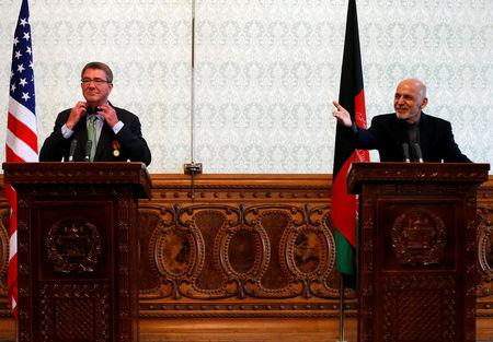 Afghanistan's President Ashraf Ghani speaks during a joint news conference with U.S. Defense Secretary Ashton Carter (L) in Kabul, Afghanistan December 9, 2016. REUTERS/Mohammad Ismail