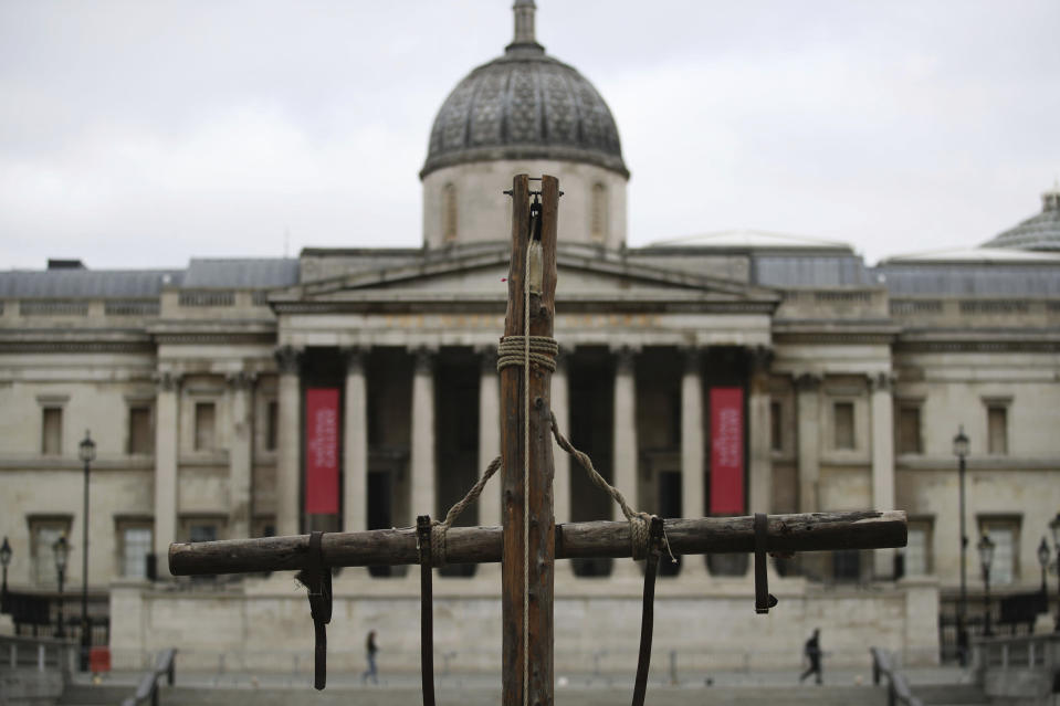 A crucifix placed in Trafalgar Square on Good Friday, the day Christians commemorate the crucifixion of Jesus and his death at Calvary, in London, Friday April 2, 2021. (Aaron Chown/PA via AP)