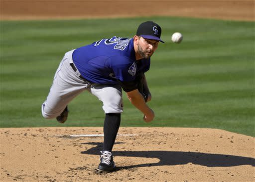 Colorado Rockies starting pitcher Tyler Chatwood throws to the plate during the second inning of the Rockies' baseball game against the Los Angeles Dodgers, Saturday, July 13, 2013 in Los Angeles. (AP Photo/Mark J. Terrill)