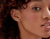 """An unexpected """"something blue"""": These studs from Lightbox Jewelry, which can be worn <a href=""""https://www.glamour.com/gallery/types-of-ear-piercings?mbid=synd_yahoo_rss"""" rel=""""nofollow noopener"""" target=""""_blank"""" data-ylk=""""slk:anywhere on the ear"""" class=""""link rapid-noclick-resp"""">anywhere on the ear</a> (think lobe, helix, or tragus). $250, Lightbox Jewelry. <a href=""""https://lightboxjewelry.com/collections/gifts/products/earrings-0-25carat-mini-solitaire-studs-blue?"""" rel=""""nofollow noopener"""" target=""""_blank"""" data-ylk=""""slk:Get it now!"""" class=""""link rapid-noclick-resp"""">Get it now!</a>"""