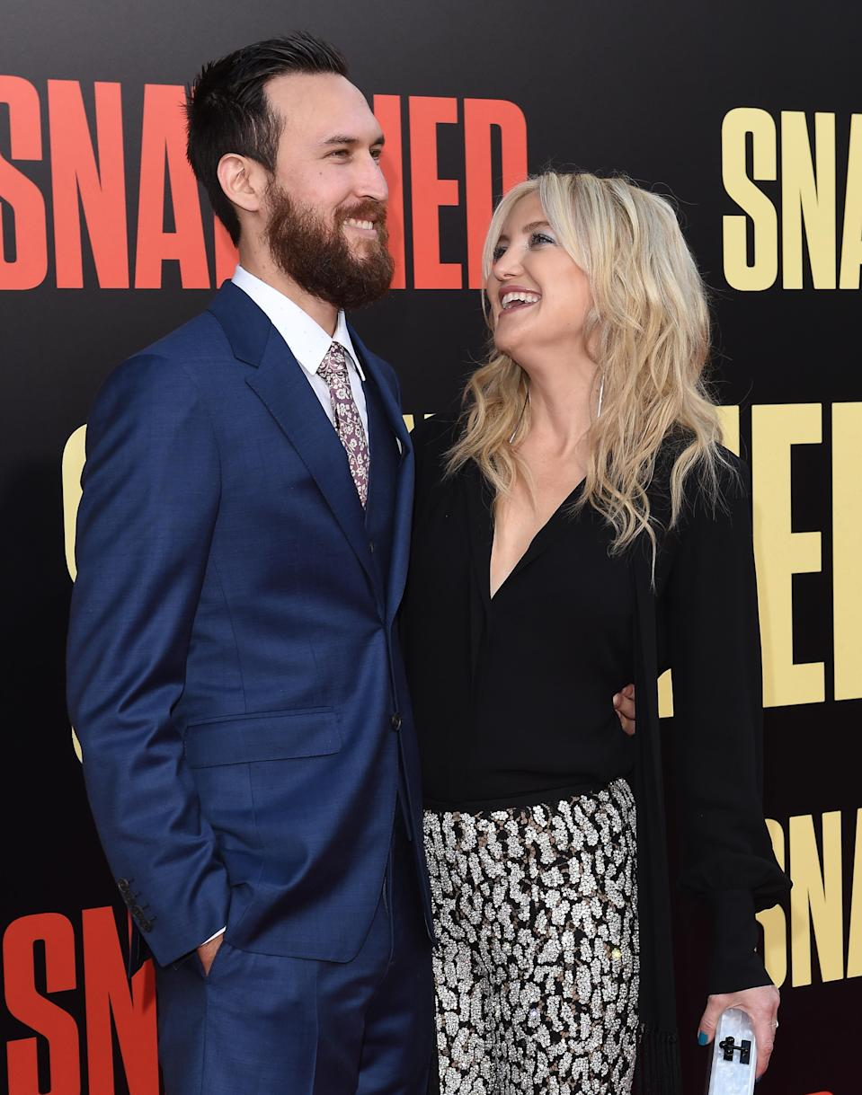 Kate Hudson, shown with boyfriend Danny Fujikawa, is expecting her third child and her first with him. (Photo: Getty Images)