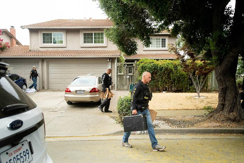 Police carry evidence bags from the home of the Gilroy shooting suspect. | Noah Berger—AP