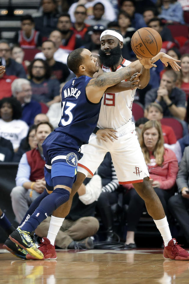Minnesota Timberwolves guard Shabazz Napier (13) reaches in to break up the pass by Houston Rockets guard James Harden, right, during the first half of an NBA basketball game Saturday, Jan. 11, 2020, in Houston. (AP Photo/Michael Wyke)