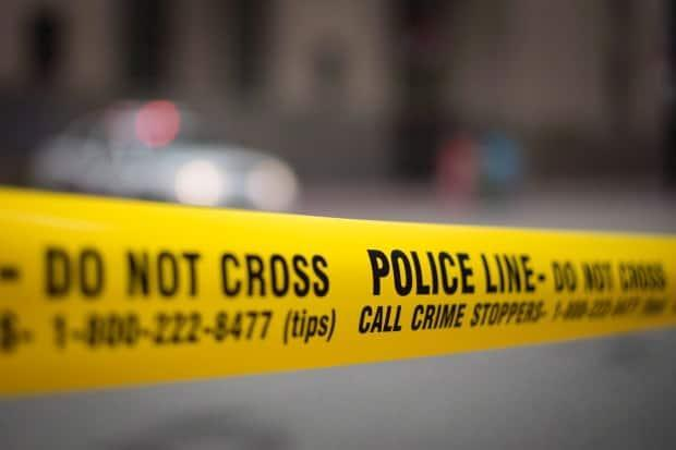 Toronto police closed a section of Bloor Street East on Tuesday while they investigated a package of interest and carried out a controlled detonation. Police said a threat was made to a government building in the area before the package was found. (Graeme Roy/Canadian Press - image credit)