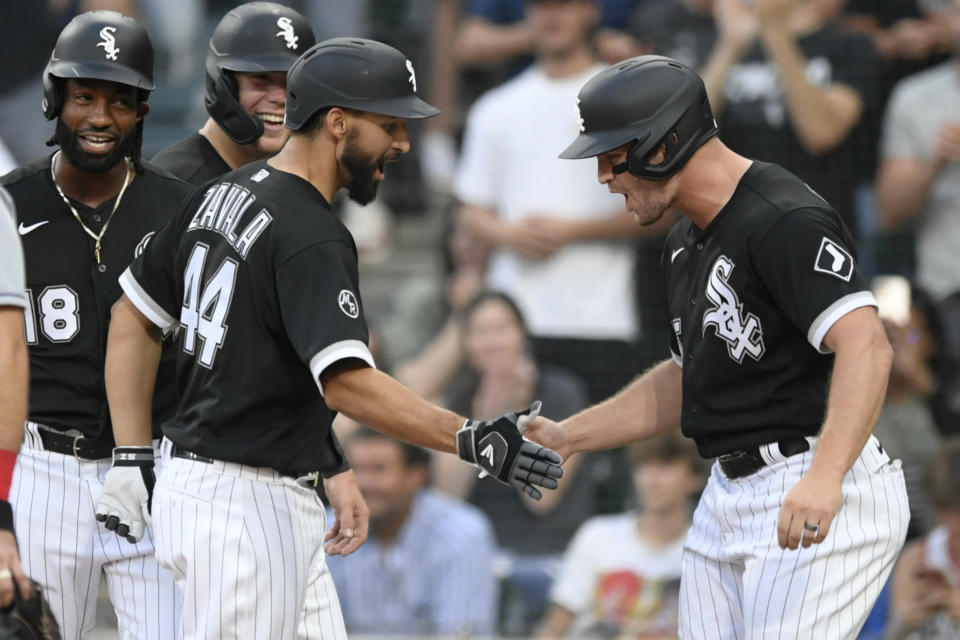Chicago White Sox's Seby Zavala (44) celebrates at home plate with Adam Engel right, after hitting a grand slam during the fourth inning of the team's baseball game against the Cleveland Indians on Saturday, July 31, 2021, in Chicago. (AP Photo/Paul Beaty)