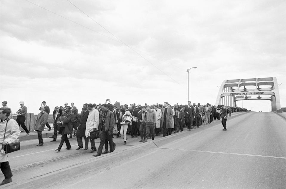 Civil rights marchers led by Martin Luther King, Jr. cross the Edmund Pettus bridge in Selma, Alabama after being turned back by state troopers. The marchers had intended to begin a 50 mile march from Selma to Montgomery to protest race discrimination in