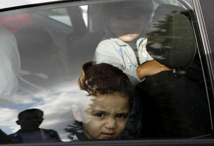 """Bushr Al Tawashi is seen through a car window, outside of a private Sigma TV station, in Nicosia, Cyprus, Friday, Oct. 26, 2012. A 2-year-old Syrian boy who was believed dead after his family inadvertently left him behind as they fled shelling in Damascus last summer has been reunited with his parents in Cyprus, a lawyer said. """"You can imagine how they felt when they were told their son was alive after bearing all this guilt thinking that he was dead,"""" lawyer Stella Constantinou told The Associated Press. (AP Photo/Petros Karadjias)"""